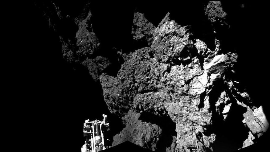 The combination photo of different images  taken with the CIVA camera system  released by the European Space Agency ESA on Thursday Nov. 13, 2014 shows  Rosetta's lander Philae as it  is safely on the surface of Comet 67P/Churyumov-Gerasimenko,  as  these first  CIVA images confirm. One of the lander's three feet can be seen in the foreground. Philae became the first spacecraft to land on a comet when it touched down Wednesday on the comet, 67P/Churyumov-Gerasimenko. (AP Photo/Esa/Rosetta/Philae)