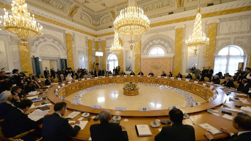 FILE - This Sept. 6, 2013 file photo shows a general view of the second working session during a G-20 summit at the Konstantin Palace in St. Petersburg, Russia. The annual G-20 leadership summit that groups democrats with authoritarians and rich nations with poor has long suffered from a perception it's all talk and no action. This year, leaders are under extra pressure to produce something tangible. (AP Photo/Dimitar Dilkoff, Pool, File)
