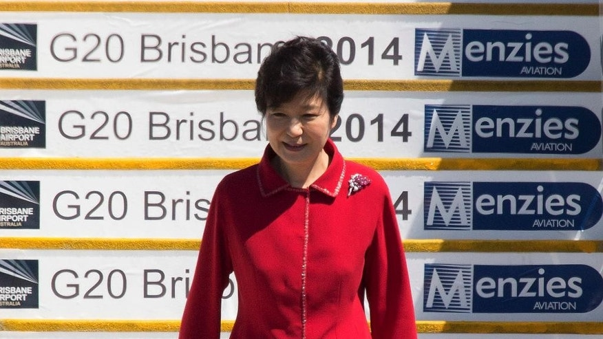 In this Friday, Nov. 14, 2014 photo released by G20 Australia, South Korean President Park Geun-hye arrives at Brisbane Airport ahead of the G-20 conference in Brisbane, Australia. The annual G-20 leadership summit that groups democrats with authoritarians and rich nations with poor has long suffered from a perception it's all talk and no action. This year, leaders are under extra pressure to produce something tangible. Australia, as this year's chair of the G-20, has been determined to give the forum new relevance, an outcome that would burnish its credentials and image on the world stage. (AP Photo/G20 Australia)