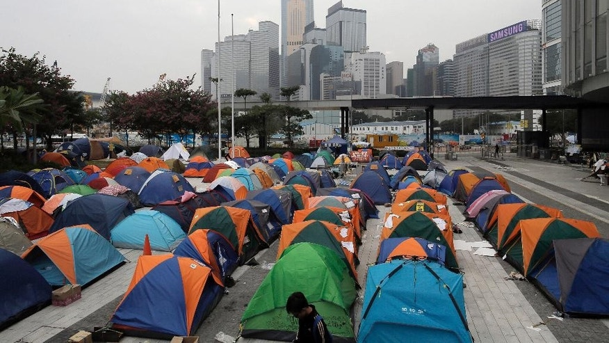 Tents set up by pro-democracy protesters are seen at an occupied area outside government headquarters in Hong Kong's Admiralty district in Hong Kong Friday, Nov. 14, 2014. Hong Kong student leaders plan to fly to Beijing Saturday to try to meet with China's top officials to press their case for a greater say in choosing the territory's next leader. (AP Photo/Vincent Yu)