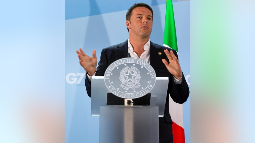FILE - In this Thursday, June 5, 2014 file photo, Italian Prime Minister Matteo Renzi speaks during a media conference at the G7 summit in Brussels. Italy's dynamo premier works with his sleeves rolled up and often without a tie. But Matteo Renzi is all business as he takes on the cozy links between Italy's political Left and its influential labor unions on a mission to revive the moribund economy. The center-left Renzi is picking a fight with his own political camp by barreling ahead with a plan to make it easier to fire workers, putting him on a collision course with union leaders, once stalwart allies of his Democratic party. (AP Photo/Virginia Mayo, Files)