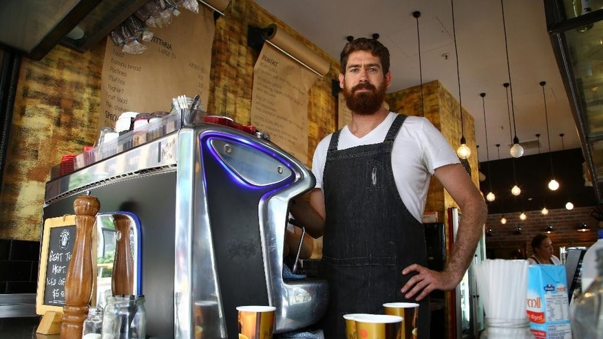 "In this Thursday Nov. 13, 2014, photo coffee shop owner Brett Fitzpatrick stands in his shop in the central business district ahead of the G-20 conference in Brisbane, Australia. Fitzpatrick said that ""the G-20 has been an opportunity for us to be exposed to different customers that are not a regular base for us, so it's been great."" (AP Photo/Mark Baker)"