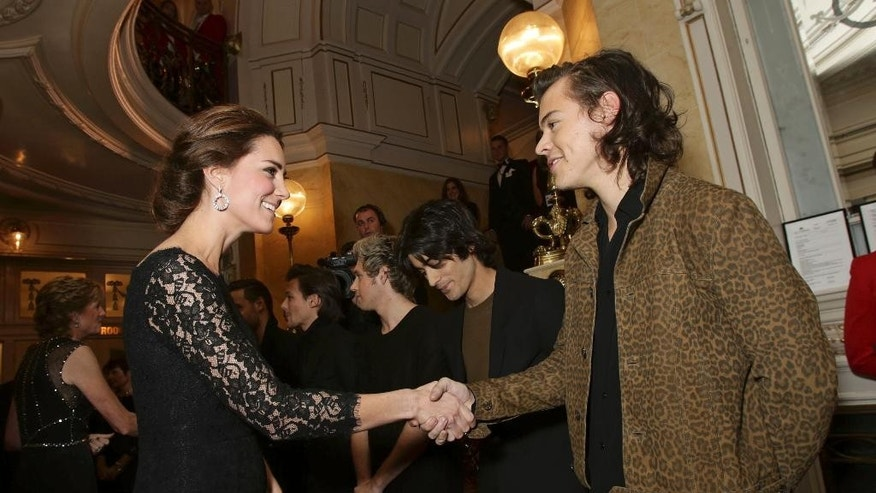 Britain's Kate, Duchess of Cambridge shakes hands with Harry Styles of the boy band One Direction at the Royal Variety Performance, in support of the Entertainment Artistes' Benevolent Fund, at the Palladium Theatre in London, Thursday, Nov. 13, 2014. (AP Photo/Yui Mok, pool)