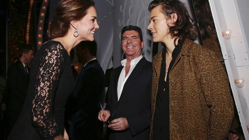 Britain's Kate, Duchess of Cambridge smles as she meets Harry Styles of One Direction, right,  as Simon Cowell looks on at the end the Royal Variety Performance, in support of the Entertainment Artistes' Benevolent Fund, at the Palladium Theatre in London, Thursday, Nov. 13, 2014. (AP Photo/Yui Mok, pool)