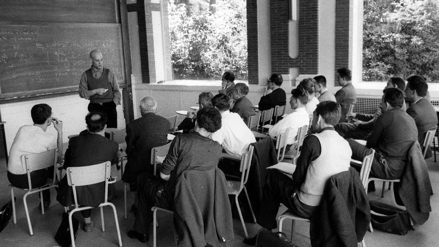 This photo provided Friday, Nov.14, 2014 by the IHES (High Scientific Studies Institute) shows mathematician Alexandre Grothendieck, at the blackboard, during a lesson, south of Paris, in the 1960's. Grothendieck, an opinionated and reclusive German-born giant of 20th-century mathematics who shunned accolades and supported pacifist and environmental causes, has died, the French presidency said Friday. He was 86. (AP Photo/IHES)