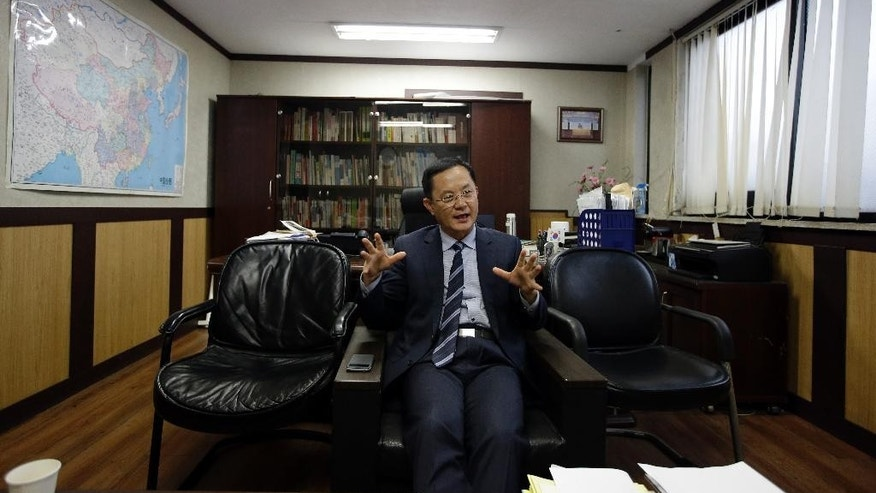 In this Oct. 21, 2014 photo, Kim Heung Kwang, a North Korean defector who heads the North Korea Intellectuals Solidarity organization, speaks during an interview at his office in Seoul, South Korea. His organization got a legitimate big scoop about the North, one of the few reports by defectors' groups to be independently confirmed: the news of the country's botched currency revaluation in 2009. South Korean officials confirmed the details days later. (AP Photo/Lee Jin-man)