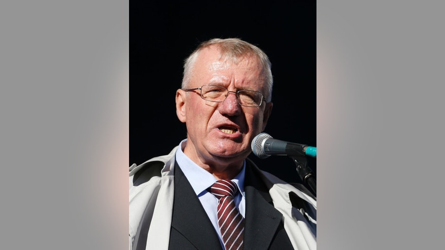 Serbian ultranationalist leader Vojislav Seselj speaks during the protest In Belgrade, Serbia, Saturday, Nov. 15, 2014. Several thousand supporters gathered in Belgrade on Saturday in support of Seselj, who is accused of recruiting notorious paramilitary forces during the bloody Balkan wars, and has returned home on a provisional release from the UN war crimes court. (AP Photo/Darko Vojinovic)