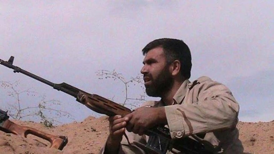 In this undated photo provided by an anti-Bashar Assad activist group Edlib News Network (ENN), which has been authenticated based on its contents and other AP reporting, shows Jamal Maarouf, the head of the rebel Syrian Revolutionaries Front, holding a rifle, in Idlib province, northern Syria. The moderate Syrian rebels that Washington hopes will battle the Islamic State extremist group are hemorrhaging on multiple fronts. In a key battle earlier this month they rapidly collapsed in the face of an assault by al-Qaida fighters, with some rebels surrendering their weapons and others outright defecting to the extremists. (AP Photo/Edlib News Network ENN)