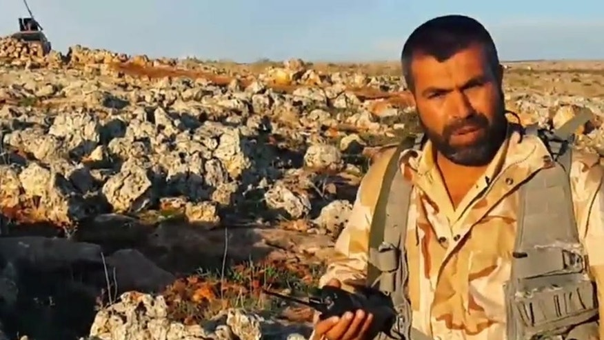 In this undated photo provided by an anti-Bashar Assad activist group, Edlib News Network (ENN), which has been authenticated based on its contents and other AP reporting, shows Jamal Maarouf, the head of the rebel Syrian Revolutionaries Front, holding a radio, in Idlib province, northern Syria. The moderate Syrian rebels that Washington hopes will battle the Islamic State extremist group are hemorrhaging on multiple fronts. In a key battle earlier this month they rapidly collapsed in the face of an assault by al-Qaida fighters, with some rebels surrendering their weapons and others outright defecting to the extremists. A string of targeted killings of top commanders has further dimmed the prospect of the moderates emerging as an effective ground force. (AP Photo/Edlib News Network ENN)