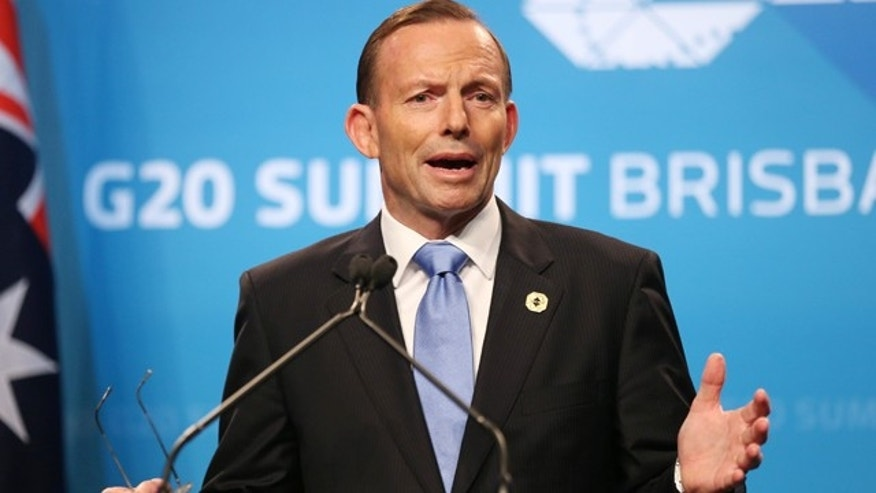 November 16, 2014: Australia's Prime Minister Tony Abbott speaks to the media during a press conference at the conclusion of the G-20 summit in Brisbane, Australia.(AP Photo/Rob Griffith)