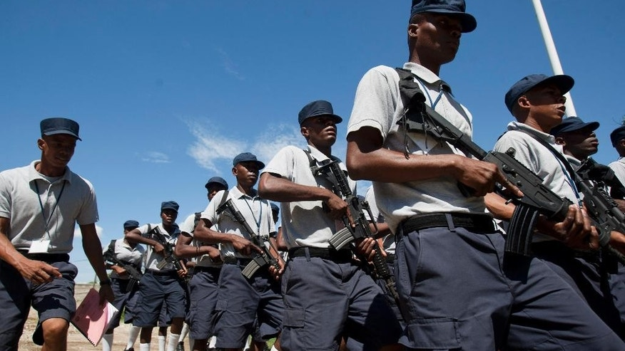 In this October 27, 2014 photo, aspiring police officers receive instruction at the National Police Academy in Port-au-Prince, Haiti. Haitians will soon rely more on their police to maintain security as the United Nations downsizes the peacekeeping force it has kept in Haiti since 2004, when a violent rebellion swept the country. While the U.N. will maintain a police contingent of 2,601, it will cut its multinational troop size from 5,021 to 2,370 in June. (AP Photo/Dieu Nalio Chery)