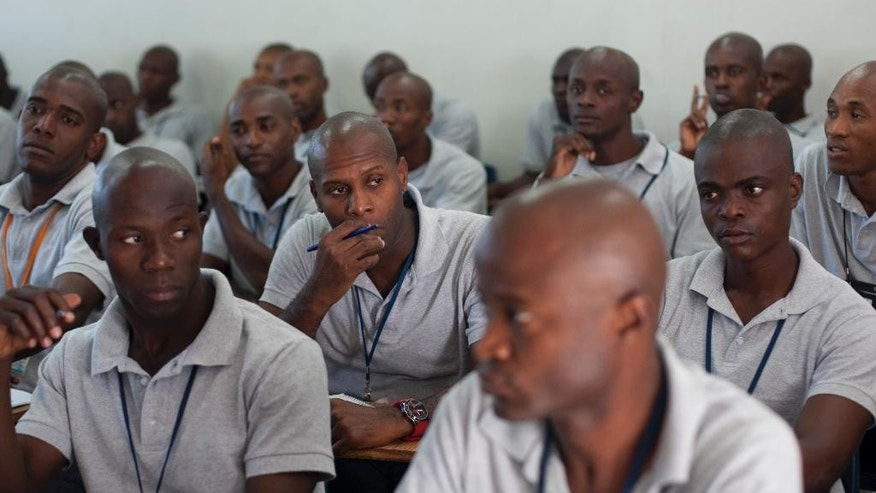 In this October 27, 2014 photo, aspiring police officers receive instruction at the National Police Academy in Port-au-Prince, Haiti. Haiti's force currently has some 11,200 officers and another 1,400 or so will be added soon. But that still falls short of the recommended minimal level. (AP Photo/Dieu Nalio Chery)