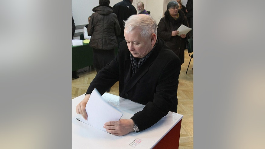Leader of the main oposition party, tha Law and Justice, Jaroslaw Kaczynski votes during the first round of Polish local elections in Warsaw, Poland, Sunday, Nov. 16, 2014.The voting is considered a test for the main parties ahead of the parliamentary elections next year.Some 30 million voters are eligible to choose nearly 47,000 councilors and 2,500 local administration leaders on Sunday, but observers are concerned about the possibility of a low turnout. Opinion polls gave a narrow lead to the governing pro-business Civic Platform party, over the nationalist opposition Law and Justice.(AP Photo/Czarek Sokolowski)