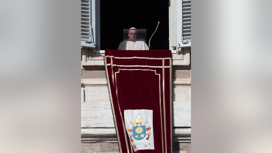 Nov. 16, 2014: Pope Francis arrives to recite the Angelus noon prayer from his studio's window overlooking St. Peter's Square, at the Vatican. (AP)