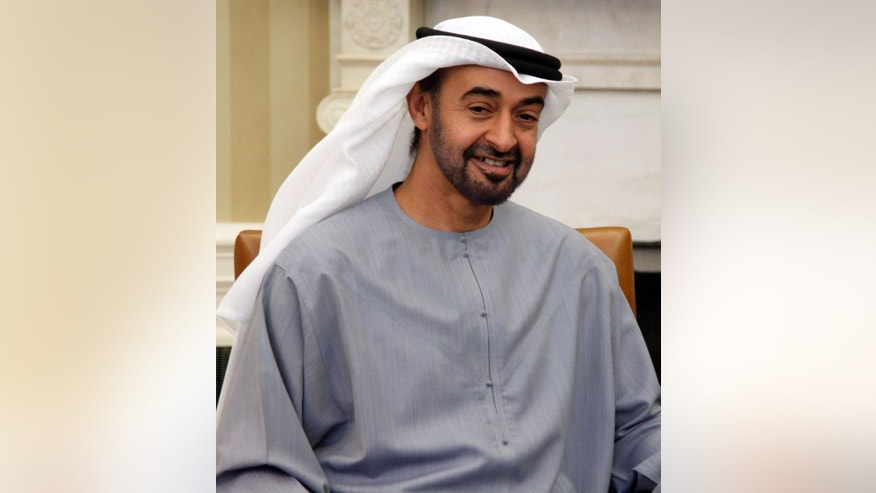 File-This April 26, 2011, file photo shows Sheikh Mohammed bin Zayed Al Nahyan of the United Arab Emirates, meeting with President Barack Obama, not shown, in the Oval Office of the White House in Washington. Saudi Arabia, the United Arab Emirates and Bahrain will reinstate their ambassadors to Qatar after withdrawing them in an unprecedented move eight months ago. (AP Photo/Carolyn Kaster, File)