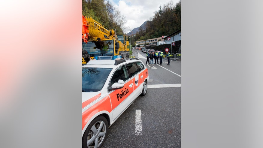 Police blocks a road  in  the village of  Davesco-Soragno near Lugano, Switzerland Sunday Nov. 16, 2014. Police say a landslide has buried a residential building near  Lugano  in southern Switzerland, leaving some  people dead,  several injured and an unknown number missing. Police spokesman Marco Tutti said the landslide occurred early Sunday morning near Lugano when heavy rain caused a hill to collapse and cover the building with masses of mud. (AP Photo/Keystone,Ti-Press/Gabriele Putzu)