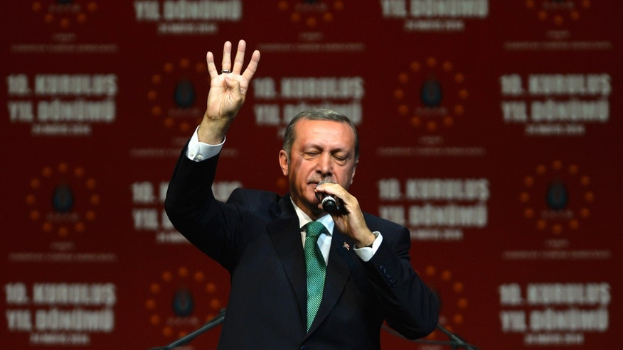 COLOGNE, GERMANY - MAY 24:  Turkish Prime Minister Recep Tayyip Erdogan speaks to Turkish expatriates at an event to mark the 10th anniversary of the UETD, the Union of European Turkish Democrats, at the Lanxess Arena on May 24, 2014 in Cologne, Germany. Erdogan faces Turkish presidential elections in August and his critics have lambasted him for his handling of the recent mine catastrophe at Soma.  (Photo by Sascha Schuermann/Getty Images)