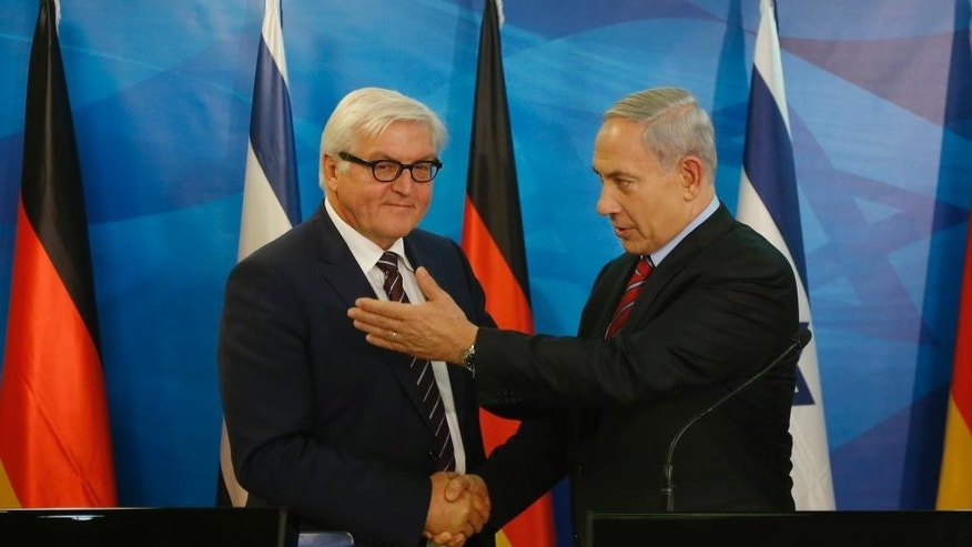 Israel's Prime Minister Benjamin Netanyahu, right, shakes hands with Germany's Foreign Minister Frank-Walter Steinmeier during their meeting in Jerusalem on Sunday, Nov. 16, 2014. (AP Photo/Ronen Zvulun, Pool)