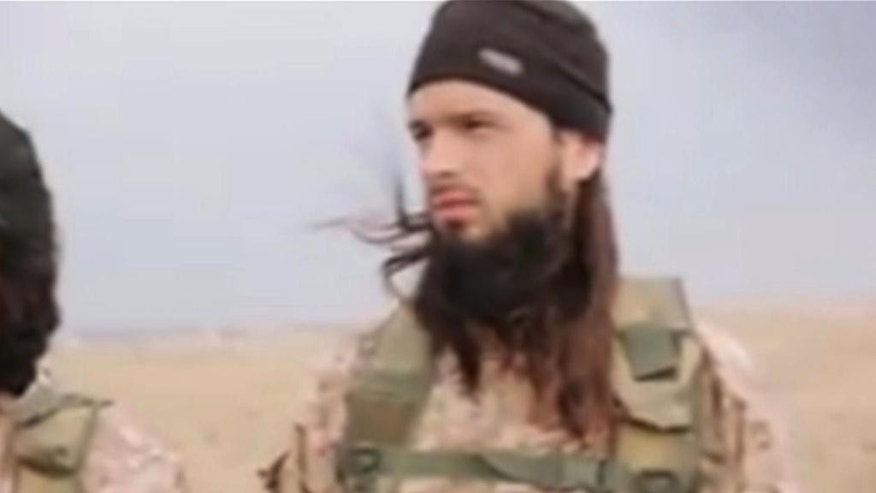 "This still image taken from an undated video published on the Internet by the Islamic State group militants and made available, Sunday, Nov. 16, 2014 shows a militant that the French government say is Frenchman Maxime Hauchard . Interior Minister Bernard Cazeneuve said there is a ""strong presumption"" that Maxime Hauchard is among the group of Islamic extremist fighters in the video released over the weekend. He urged young people in France to ""open your eyes to the terrible reality"" of the militant group. The high-definition video shows the beheadings of about a dozen men identified as Syrian military officers and pilots, all dressed in blue jumpsuits. The Associated Press could not independently verify the footage, though it appeared on websites used in the past by the Islamic State group, which now controls a third of Syria and Iraq. (AP Photo)"