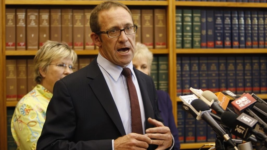 Andrew Little delivers his acceptance speech after being elected as the new leader of the opposition Labour Party Tuesday, Nov. 18, 2014, in Wellington, New Zealand. Little won from among four candidates after the party suffered a big election defeat two months ago, prompting former leader David Cunliffe to step down. (AP Photo/Nick Perry)