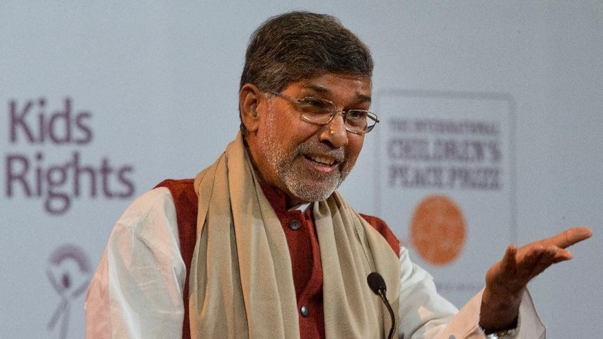 Indian children's rights advocate and Nobel Peace Prize winner Kailash Satyarthi gestures when speeching during the KidsRights Children's Peace Prize award ceremony in The Hague, Netherlands, Tuesday, Nov. 18, 2014. (AP Photo/Peter Dejong)