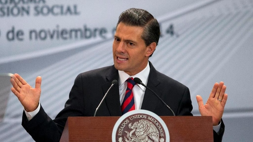 Mexican President Enrique Pena Nieto speaks during an event announcing World Bank support for Mexico's Prospera social net program at Los Pinos presidential residence in Mexico City, Wednesday, Nov. 19, 2014. Mexico's first lady said late Tuesday that she will sell her interest in a personal home built and still owned by a company that has gained millions in contracts under the president, an apparent effort to quell a conflict-of-interest scandal that has surrounded the couple. (AP Photo/Rebecca Blackwell)