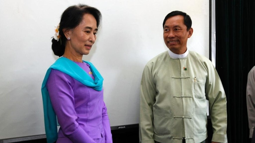 FILE - In this April 9, 2013 file photo, Myanmar's Speaker of Parliament Shwe Mann, right, and opposition leader Aung San Suu Kyi, left, attend a meeting for the renovation of Yangon General Hospital, in Yangon, Myanmar. The influential speaker of the parliament said Tuesday, Nov. 18, 2014,  the military-drafted constitution that bars opposition leader Suu Kyi from becoming president will not be changed before next year's general election. (AP Photo/Khin Maung Win, File)