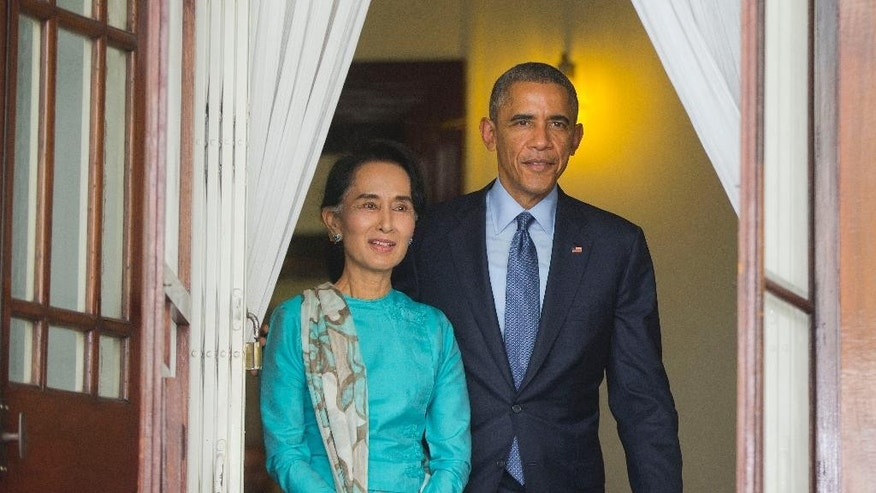 FILE - In this Nov. 14, 2014 file photo, Myanmar's opposition leader Aung San Suu Kyi, left, walks out with U.S. President Barack Obama, right, at her home to begin their joint news conference in Yangon, Myanmar. The influential speaker of Myanmar's parliament Shwe Mann said Tuesday, Nov. 18, 2014,  the military-drafted constitution that bars opposition leader Aung San Suu Kyi from becoming president will not be changed before next year's general election. (AP Photo/Pablo Martinez Monsivais, File)