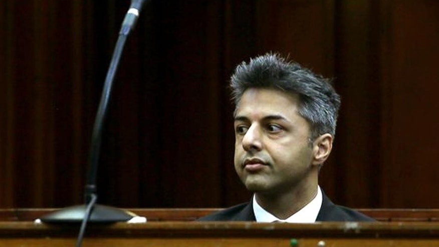FILE - In this Monday, Oct. 6, 2014 file photo, British businessman Shrien Dewani appears in the high court in Cape Town,  South Africa charged with orchestrating the killing of his wife Anni Dewani, while on honeymoon in the country four years ago. Dewan's lawyer, Francois van Zyl, said he plans to file an application on Wednesday, Nov.19, 2014 on the basis that state prosecutors had failed to prove that their client had orchestrated his wife's murder. The prosecution is expected to file their response on Friday. (AP Photo/Nardus Engelbrecht, Pool, File)