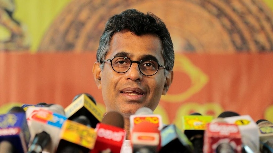 Sri Lankan Technology and Research Minister Champika Ranawaka addresses a press conference, in Colombo, Sri Lanka, Tuesday, Nov. 18, 2014. Ranawaka, who represents the National Sinhala Heritage party, resigned Tuesday from the Cabinet after Sri Lankan President Mahinda Rajapaksa refused to agree to the party's 35 demands, including making him answerable to Parliament and the courts. (AP Photo/Eranga Jayawardena)