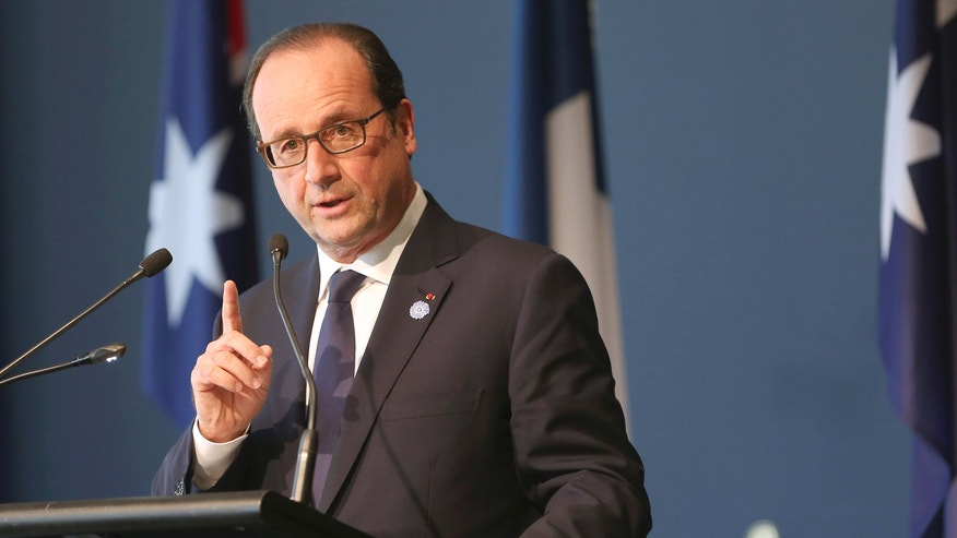 Nov. 19, 2014: French President Francois Hollande raises his finger as he speaks at the National Gallery of Australia in Canberra, Australia