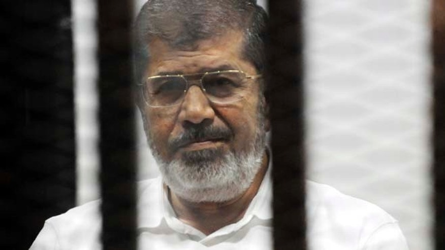 Nov. 3, 2014: Egypt's ousted Islamist President Mohammed Morsi sits in the defendant cage in the Police Academy courthouse during a court hearing on charges of inciting the murder of his opponents, in Cairo, Egypt. (AP)