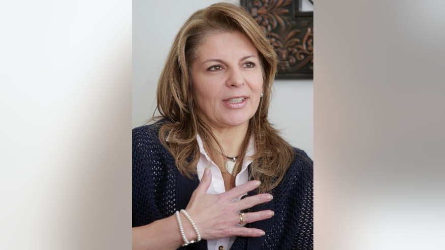 Claudia Farfan, wife of Army Gen. Ruben Dario Alzate speaks during an interview with The Associated Press at her home in Bogota, Colombia, Wednesday, Nov. 19, 2014. Gen. Alzate, dressed in civilian clothes, was snatched on Nov. 16 by rebels of the Revolutionary Armed Forces of Colombia, FARC, along with two others traveling in a boat through the jungled waterways of western Colombia. President Juan Manuel Santos immediately suspend two-year-old peace talks with the rebel group and ordered a search operation for the highest-ranking officer ever taken by the rebels. (AP Photo/Cristian Alvarez)