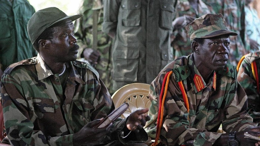FILE - In this Nov. 12, 2006 file photo the leader of the Lord's Resistance Army, Joseph Kony, left, and his deputy Vincent Otti sit inside a tent at Ri-Kwamba in Southern Sudan. Warlord Joseph Kony's Lord's Resistance Army rebel group is increasingly trafficking in ivory and minerals to obtain weapons and other supplies to be used in the jungles of central Africa, watchdog groups said in a report released Wednesday, Nov. 19, 2014. (AP Photo/Stuart Price, File, Pool)