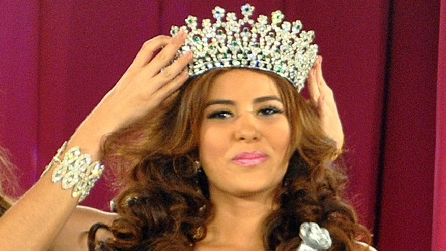 In this April 26, 2014 photo, Maria Jose Alvarado is crowned the new Miss Honduras in San Pedro, Sula, Honduras. Alvarado, and her sister Sofia disappeared after attending a birthday party in Western Honduras on Thursday Nov. 13, but authorities were not notified until the weekend.  The 19-year-old beauty queen was expected to attend the Miss World pageant in Britain this December. (AP Photo)