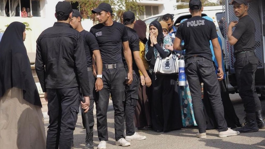 Nov. 19, 2014: Egyptian police officers detain students following a protest to commemorate the 2011 clashes known as the Mohammed Mahmoud Battle, while at the campus for female students at Al-Azhar University in Cairo, Egypt. (AP)