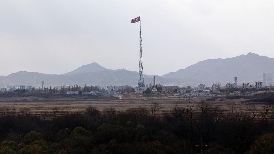In this Wednesday, Nov. 12, 2014 photo, a North Korean flag flutters in the wind atop a 160-meter (533-foot) tower in the village of Gijungdong, near the North side of the border village of Panmunjom, which has separated the two Koreas since the Korean War, north of Seoul, South Korea. North Korea threatened Thursday, Nov. 20, 2014 to bolster its war capability and conduct a fourth nuclear test to cope with what it calls U.S. hostility that led to the approval of a landmark U.N. resolution on its human rights violations. (AP Photo/Lee Jin-man)