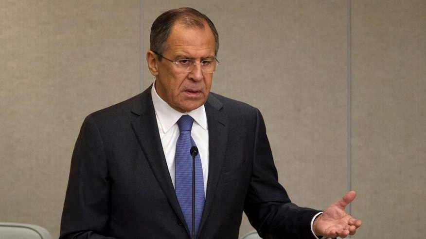 Russian Foreign Minister Sergey Lavrov gestures as he answers questions during the session of the State Duma, Russian Parliament's lower chamber, in Moscow, Russia, Wednesday, Nov. 19, 2014. Lavrov on Wednesday claimed that Ukraine's decision to freeze budget payments to the eastern rebel-held territories could be a precursor to a military onslaught. (AP Photo/Ivan Sekretarev)