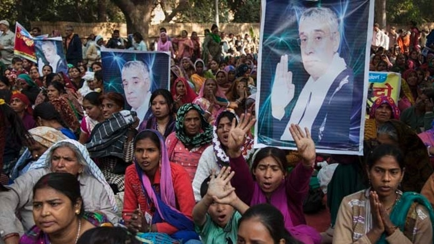 Nov. 18, 2014: Supporters of controversial Indian guru Sant Rampal displaying his photographs, chant slogans praising him as they gather to show support at a protest venue near the Indian Parliament in New Delhi, India. In the neighboring Haryana states Hisar district, several supporters were injured on Tuesday after police searching for Rampal stormed an ashram where he was believed to be holed up.