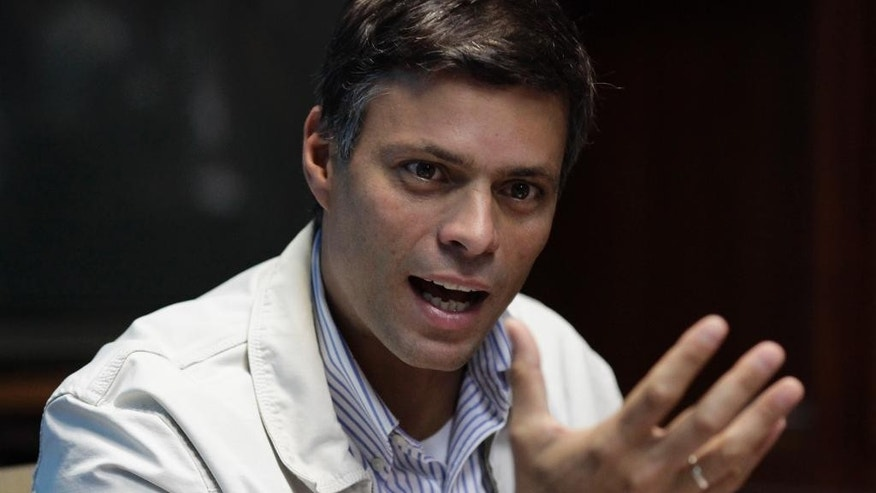 FILE - In this Feb. 26, 2013 file photo, opposition leader Leopoldo Lopez gives a press conference in Caracas, Venezuela. Lopez says he will skip his own trial to draw attention to a United Nations request for his freedom. He has been jailed since February for his role in the street demonstrations that shook the socialist country earlier this year. He faces charges of inciting violence. (AP Photo/Ariana Cubillos, File)
