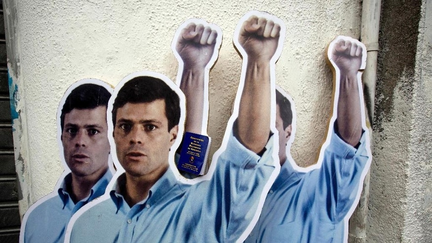 FILE - In this July 23, 2014 file photo, life-size cardboard cutouts of opposition leader Leopoldo Lopez, placed by his supporters, stand outside the Justice Palace as his trial begins in Caracas, Venezuela. Lopez gave an impassioned speech in court Tuesday, Nov. 18, 2014 saying he would waive his right to be present at hearings until an appeals court rules on whether to comply with U.N. calls for his freedom. Lopez has been jailed since February for his role in the street demonstrations that shook the country earlier this year. He faces charges of inciting violence. (AP Photo/Fernando Llano, File)