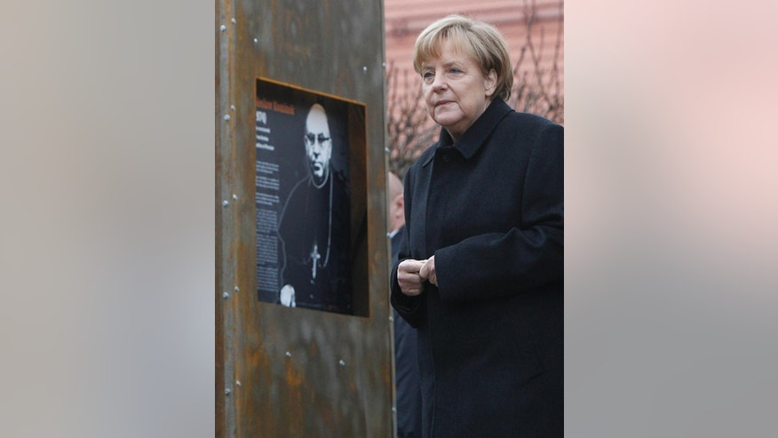 "German Chancellor Angela Merkel   walks   as she visits an exhibition, during celebrations  to commemorate   25 years since a symbolic reconciliation between the two neighboring nations whose  ties  were  marked by warfare in Krzyzowa, Poland, Thursday Nov. 20, 2014. Speaking on the occasion,  Merkel  stressed that security, freedom and the rule of law are made even more valuable today, when Ukraine's territorial integrity has been violated. ""We are aware that only together with Russia we can assure Europe's long-term security,"" Merkel said.    (AP Photo/Czarek Sokolowski)"
