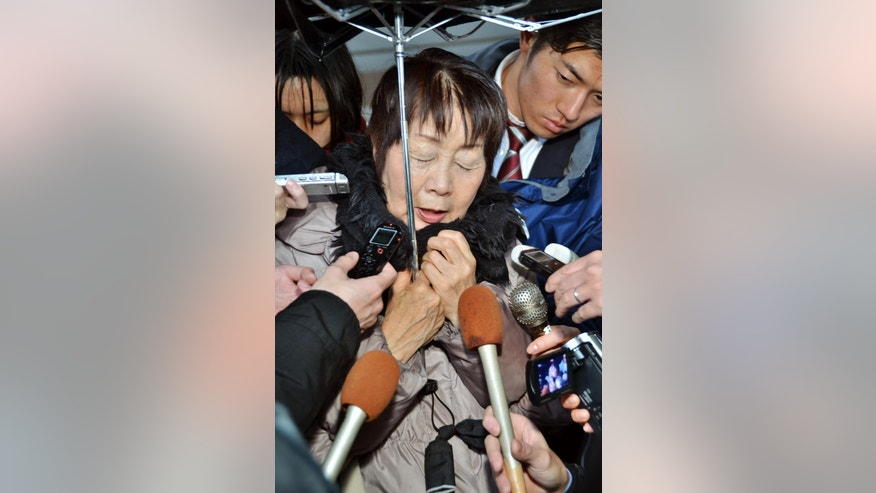 In this photo taken in March, Chisako Kakehi is surrounded by reporters in Sakai, western Japan. Japanese police arrested the 67-year-old woman whom they suspect poisoned her husband late last year, one of about half a dozen former husbands or partners of the woman who have died. She has denied involvement in the deaths. Kyoto prefectural police arrested Kakehi on Wednesday, Nov. 19, 2014 after cyanide was found in the body of her 75-year-old husband, according to Japanese media reports. (AP Photo/Kyodo News) JAPAN OUT, MANDATORY CREDIT