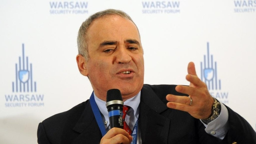 Russian chess master and political activist Garry Kasparov speaks at the Warsaw Security Forum, in Warsaw, Poland, Thursday, Nov. 20, 2014. Kasparov warned that if the west fails to stop Russia's President Vladimir Putin now,  the price for doing so could get much higher. (AP Photo/Alik Keplicz)