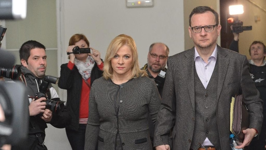 Jana Necasova, left, wife of former Czech prime minister Petr Necas, right, accused of abusing of Military Intelligence, comes to the Prague 1 district court in Prague, Czech Republic, Thursday, Nov. 20, 2014. Necasova, formerly Nagyova, two former heads of the military intelligence agency and an intelligence agent will face charges of misuse of power. (AP Photo/CTK, Michal Dolezal)  SLOVAKIA OUT