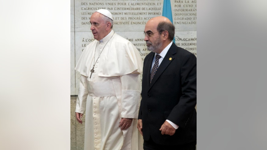 Pope Francis is flanked by FAO Director-General Jose Graziano Da Silva as he arrives to attend a session of the United Nations Food and Agriculture Organization (FAO) second International Conference on Nutrition, in Rome, Thursday, Nov. 20, 2014. The conference, jointly organized by FAO and the World Health Organization (WHO), takes place at FAO headquarters in Rome from Nov. 19 to 21. (AP Photo/Andrew Medichini)