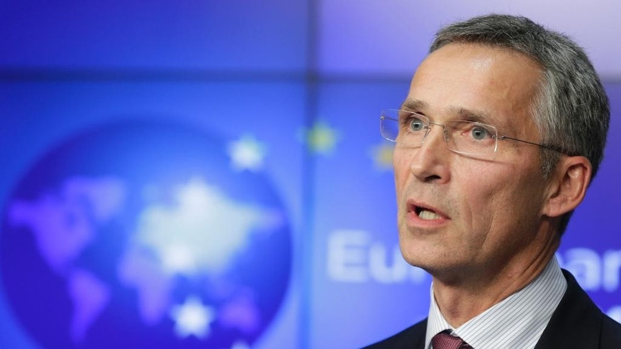 """FILE - This is a Tuesday, Nov. 4, 2014 file photo of NATO Secretary General Jens Stoltenberg as he addresses the media after meeting with EU foreign policy chief Federica Mogherini, at the European External Action Service (EEAS) building in Brussels. Stoltenbeg said Thursday Nov. 20. 2014 that Russia's increased military activity in the skies above the Baltic region is """"unjustified"""" and poses a risk to civil aviation because aircraft regularly fail to file flight plans or communicate with air controllers. (AP Photo/Yves Logghe, File)"""