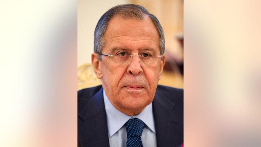 Russian Foreign Minister Sergey Lavrov listens during his meeting with North Korea's special envoy Choe Ryong Hae in Moscow, Russia, Thursday, Nov. 20, 2014. Earlier Russian President Vladimir Putin met with Choe, the special envoy of North Korean leader Kim Jong Un, who delivered a letter from Kim. No further details were given. (AP Photo/Ivan Sekretarev)