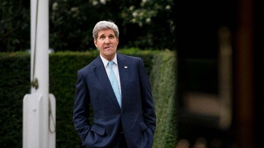 U.S. Secretary of State John Kerry waits for the arrival of Oman Foreign Minister Yusuf Bin Alawi bin Abdullah for their meeting at the official residence of the U.S. ambassador to Britain, Winfield House, in London, Tuesday, Nov. 18, 2014.  (AP Photo/Matt Dunham)