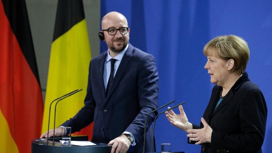 German Chancellor Angela Merkel, right, and the Prime Minister of Belgium, Charles Michel, left, address the media during a joint press conference as part of a meeting at the chancellery in Berlin, Germany, Friday, Nov. 21, 2014. (AP Photo/Michael Sohn)